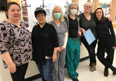L TO R: TEAM MEMBERS RACHEL JONES AND ULUJUK SATEANA WITH MIDWIVES FLEUR MCEVOY, KELLIE THIESSEN, ANGELA JONES AND EMILY STUART-WILSON AT RANKIN INLET BIRTHING CENTRE.