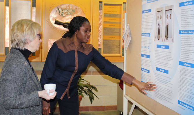 MCNHR - student explain research to visiting professor