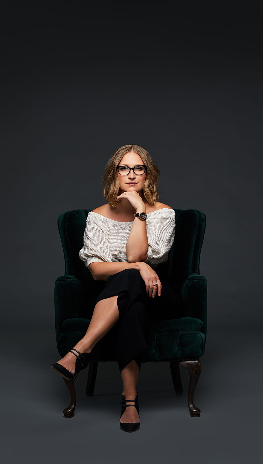 Amy Oliver sitting in a chair.