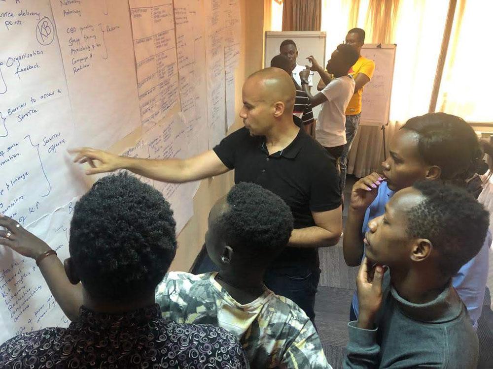 Dr. Robert Lorway works on data analysis with health activists from the cities of Kisumu, Kiambu and Mombasa, Kenya.