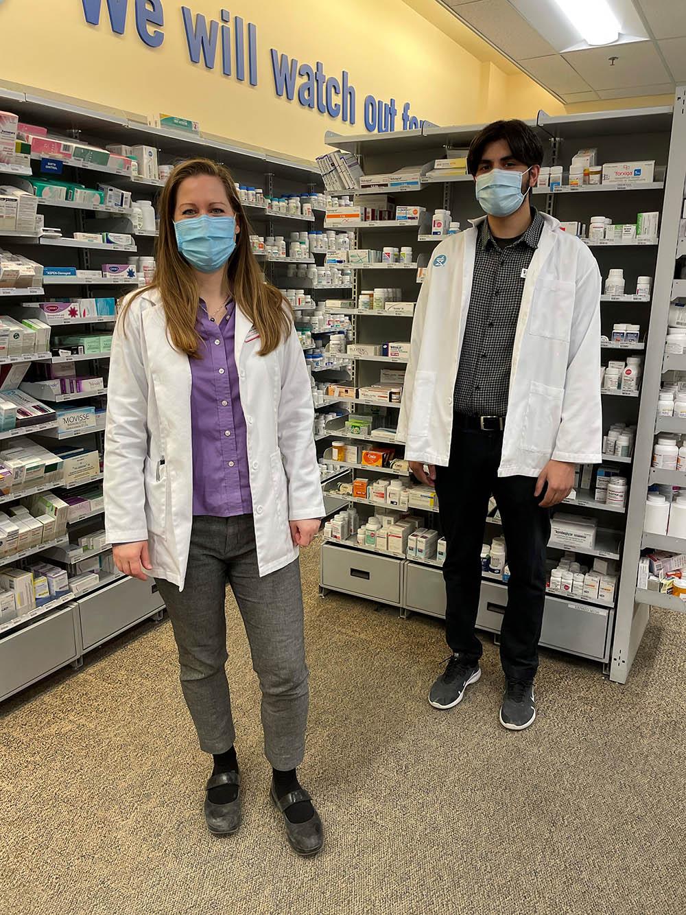 PharmD student Karn Chahal stands with his preceptor, pharmacist Erika Simpson .